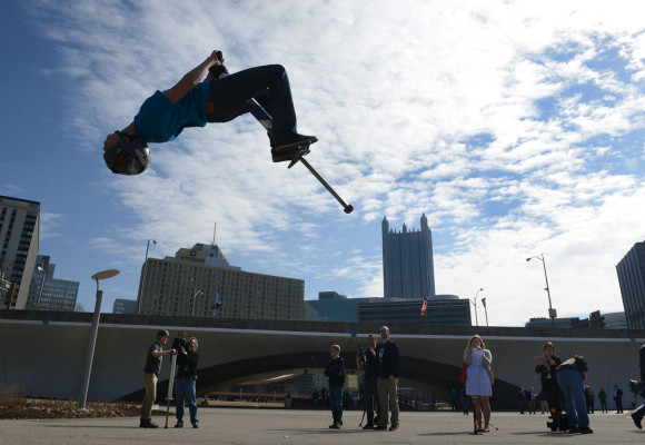 Darrell Sapp / Post-Gazette / Pittsburgh --- 03/11/2014 --- for Local --- Stand Alone ???? --- Pogopalooza 2014 ---- Henry Cabelus (cq) , 14 years old of New Hope , Pa.,  ,  flips  on his Pogo in Point State Park .  He was  promoting the Xpogo 's USA leg of its World Championship Series,  three day event at the  37th annual EQT Pittsburgh Three Rivers Regatta scheduled for July 2-4 at Point State Park.  Henry and Tone Staubs were  making heights of 14 feet during his promotion        local fea    stand alone????   03/11/2014  photo by darrell sapp   digital image #dsc_8614      slug --- 20140311dsPogopaloozaLoc02.jpg